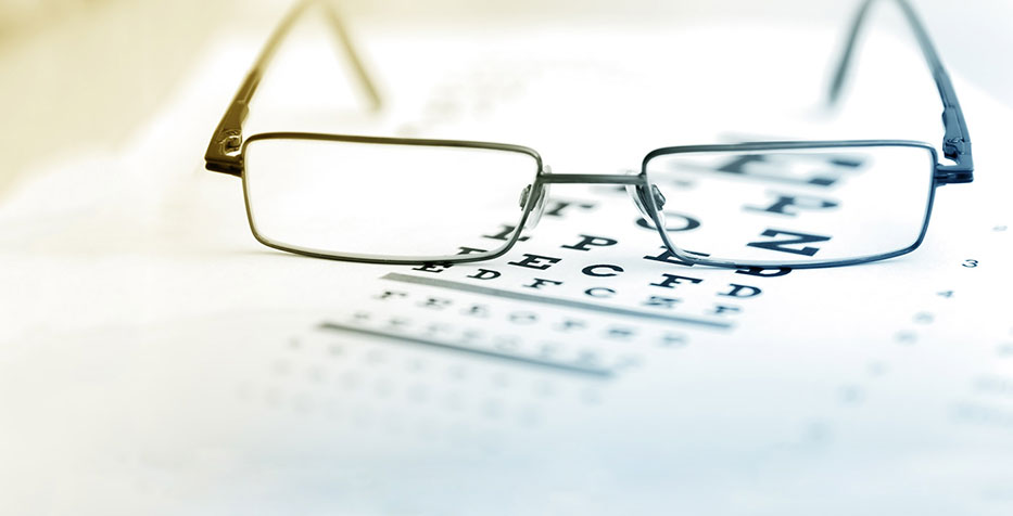 image of eye glasses on an eye chart.